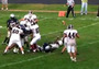 High School QB Throws TD Practically on His Back