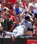 Carlos Santana Tackles Fan in the Stands