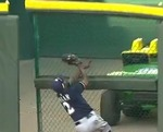 Brewers' Morgan Crashes into Gate,