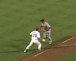 Reds' Cairo Misses Tag and Drops th