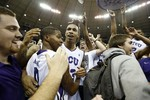 TCU Rushes Court after Upset of No.