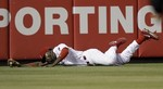 Phillies' Brown Lays Out for Catch