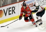 Blackhawks Cruise Past Wild to Adva