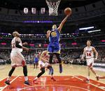 Curry Racks Up Triple-Double in Thr
