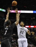 Duncan, Spurs Top Heat