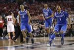 Late 3 Lifts Kentucky Over Wisconsi