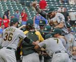 A's in, M's out After Gray's Shutou