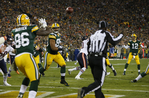 Rodgers Throws Six TDs to Rout Bear