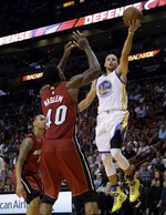 Curry's 40 Lifts Warriors Over Heat