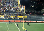 Fan Climbs Goalpost During CFL Game
